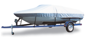 White speed boat on trailer, with vinyl cover